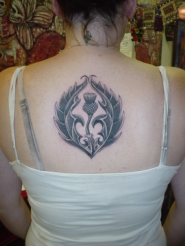 Tattoo is lotus girl back