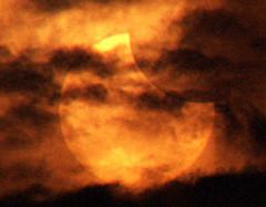 Solar eclipse (Mangiwau) Tags: sunset sun moon indonesia observation solar eclipse java afternoon cloudy jakarta astronomy cosmic partial annulus matahari bulan earthasia