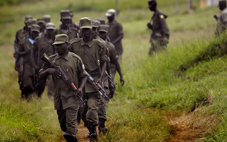 A column of Ugandan soldiers operating in southern Sudan against rebels from the Lord's Resistance Army (LRA). There have been joint operations between the Ugandan, Rwandan and DRC governments against various rebel groups operating in the region. by Pan-African News Wire File Photos
