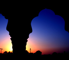 Framed Sunset (Sudhamshu) Tags: blue sunset orange silhouette dedication poetry colours haiku framed explore baroda gujarat vadodara toomuchediting lakshmivilaspalace