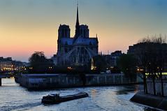 The 9pm barge (jmvnoos in Paris) Tags: sunset paris france seine 50mm nikon cathedral cathedrals notredame cathédrale notre dame péniche fr barge notredamedeparis coucherdesoleil barges d300 péniches cathédrales jmvnoos afs50mmf14g afsnikkor50mm114g