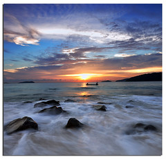 There is no blue without yellow and without orange. (Nora Carol) Tags: sunset seascape rock boat waves slowshutter malaysianphotographer nikond90 noracarol vincentvangoghquotes sabahanphotographer landscapephotographerfromsabah womanlandscapephotographer womaninphotography