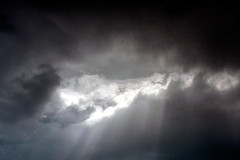 (< brian >) Tags: light sun clouds dark skies cloudy godlight