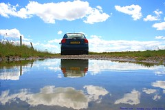 The end of the road....... (law_keven) Tags: blue england sky cars water car clouds reflections puddle suffolk toyota reflective minsmere explore500