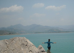 Freedom. (nida.) Tags: pakistan lake nature girl pose freedom rocks dam candid breeze titanic khanpur