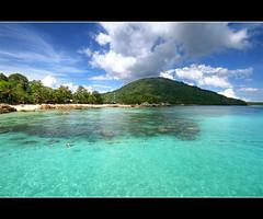 perhentian (Pawel Papis Photography) Tags: ocean trees holiday beach water rocks asia hill malaysia hdr sigma1020 3ex canon400d besarisland perhetianislands tropicislands
