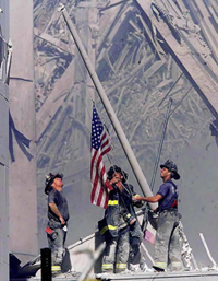fire fighters raising american flag