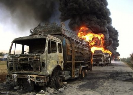 afghan_protester_burn_nato_tankers_apr25_10