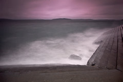 Seawall Stairs in Storm (Jeff Engelhardt) Tags: ocean seattle sea storm stairs canon timelapse waves purple magenta seawall timeexposure filter nd alki pugetsound gnd biggerisbetter goodpoint 40d richeyviewpoint eraseafterreading stormyseawallstairs ismorealliterative soiwonteraseit