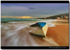 Drifting & Dreaming.. (tolis*) Tags: sea beach canon island coast boat sand long exposure waves tokina greece wreck drifting drift chios waterworld 1224f4 naturepoetry golddragon karfas eos400d tolis holidaysvacanzeurlaub favemegroup4 overtheexcellence goldstaraward alemdagqualityonlyclub alemdaggoldenaward flioukas peregrino27newvision