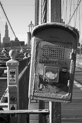 Brooklyn's Emergency (bbecker) Tags: city nyc newyorkcity bridge bw white newyork black lines brooklyn call phone view box manhattan bridges brooklynbridge emergency phonebox calls emergencies