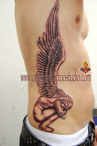 Crouching Angel Tattoo Tattooed by