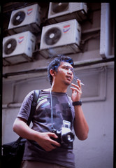 32810026 (Nasey) Tags: portrait people film slide olympus smoking malaysia kualalumpur fujichrome provia zuiko provia100f bukitbintang 50mmf14 pentaconsixtl fuad om2n nasey rupajiwa nasirali wanfuad makmalterbang