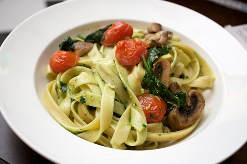 spinach pesto pasta with mushrooms, baby roma tomatoes and wilted spinach