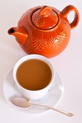 Orange Teapot and cup of tea (Cindy Farr-Weinfeld) Tags: orange colorful tea teapot teacup porcelain