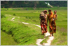 The bond we share. [..Birishiri, Bangladesh..] (Catch the dream) Tags: road girls green field childhood women afternoon village child walk bongo stroll bengal bangladesh zigzag stree serpentine bangladeshi womanhood netrokona birishiri familygetty2010 gettyimagesbangladeshq2