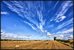August Sky. (Pat Dalton...) Tags: blue sky white house building grass clouds canon raw leicestershire sigma hedge fields hay bales stubble 1770mm 450d peatlingmagna contrastmaster pdeee454