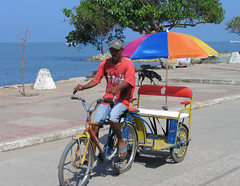 IMG_9756.JPG (Tanenhaus) Tags: sea bicycle umbrella mar town colombia gulf taxi caribbean golfo caribe tolu morrosquillo