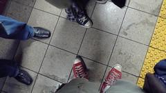 A look down: pants. (Rob Blatt) Tags: nyc subway shoes manhattan converse canalstreet wtrain chucktaylors nopants pantless rtrain improveverywhere pantssubwayride canalstreetsubway