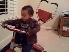 Amani and his new bike