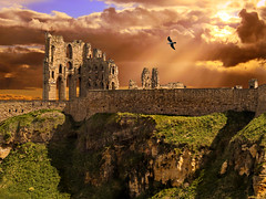 The Sun Shines On The Righteous (DDA / Deljen Digital Art) Tags: uk pink blue light red england cloud building green stone architecture photoshop ancient digitalart ruin created northumberland creation imagination layers photographicart sunrays tynemouth tynemouthpriory beams imaginative clifftop skychange colourgalour