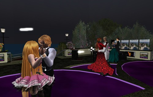Description: Three couples dancing in the evening, in different clothes from before.