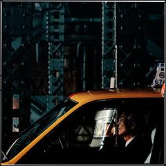 """How many more miles to go?""; Elderly cab-driver, Yurakucho, Tokyo (Alfie | Japanorama) Tags: old bridge car yellow japan dark asian japanese tokyo nikon asia iron driving gloomy cab taxi working railway mature elderly toyota older driver cabbie worker dim yurakucho d300 nikkor85mmf14afd"