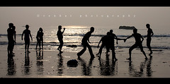 Kabbadi (venkatfotos) Tags: sea india beach boys horizontal reflections fun boat team play stones young archive wideangle vizag venkat vishakapatnam andhrapradesh kabbadi canon1855mmlens canon40d venkatphotography