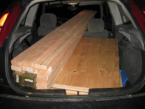 lumber in old hatchback