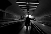 Tunnel (macropoulos) Tags: man topf25 silhouette underground walking 500v20f metro corridor tunnel trenchcoat 500v50f canonef2470mmf28lusm movingwalkway canoneos5d gabardine 1500v60f 1000v40f 50faves50comments500views artlegacy committeeofartists