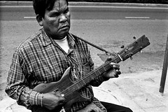 """Les Paul Thai style - Bangkok, city of angels (Sailing """"Footprints: Real to Reel"""" (Ronn ashore)) Tags: life street people blackandwhite men film musicians portraits faces blind traditional poor blues buskers blindness sightless agfaapx400"""