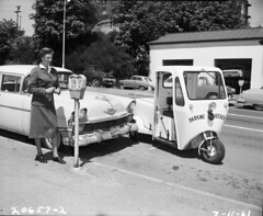 Parking checker at 5th and Cherry, 1961 (Seattle Municipal Archives) Tags: seattle classic cars work vintage washington working police historic 1950s wa 1960s parkingmeters metermaid metermaids cushmans seattlemunicipalarchives parkingcheckers parkingchecker nleaf historicmetermaid