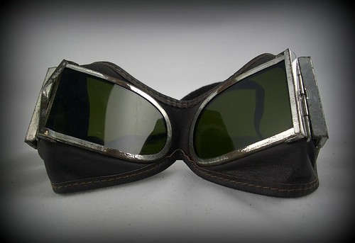 These hinged, leather Chinese mountain troop goggles have tinted lenses on the front and side so you can check out all the cool machines and art and naked people in your periphery without looking risking whiplash or looking like a sleazoid