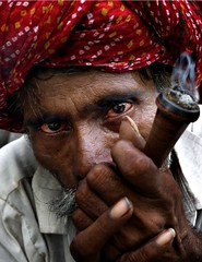 smoker (nandadevieast) Tags: travel red portrait india face eyes jaipur rajasthan chilam anuragagnihotri nandadevieast