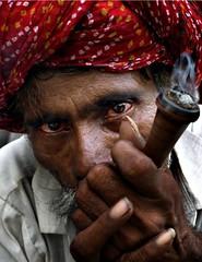 smoker (nandadevieast) Tags: travel red portrait india face eyes jaipur rajasthan chilam anuragagnihotri nandadevieast