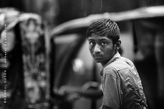 Silent Words ... (Kamrul - Hasan) Tags: road street boy portrait wet face rain silent sad young curious bangladesh profession coxsbazaar canonef135mmf2l