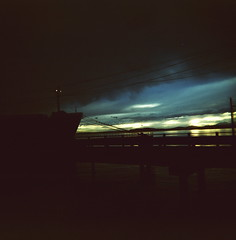 Mooring Gulls (liquidnight) Tags: seattle sunset sky seagulls colour 120 birds clouds mediumformat pier boat holga twilight xpro dock ship kodak dusk gulls birding slidefilm professional powerlines bow crossprocessing mooring pugetsound ektachrome birdwatching larus 120cfn e100g occidentali shipsbow