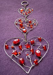Trinity - a beaded heart suncatcher in three parts