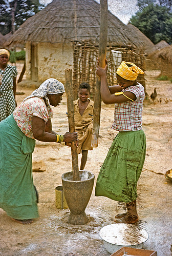 Angolan women pounding corn