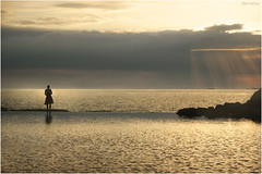 Evening Falling (Ben Heine) Tags: ocean travel light sunset sea wild woman sun mer seascape france reflection art love nature weather silhouette clouds sunrise season print landscape photography countryside back brittany poem photographie time nikond70 earth geometry lumire femme details horizon north bretagne philosophy souvenir harmony memory poet planet terre romantic normandie spirituality moment remembrance conceptual capture copyrights paysage loin depth contrejour saintmalo faraway sauvage lointain digitalshot petersquinn benheine benjaminheine hubertlebizay hubzay flickrunited bluegoldsky flickrunitedaward adaythatissoongone infotheartisterycom