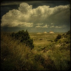looking north (jssteak) Tags: summer sky clouds colorado rocks cliffs dirt grasses plains distressed yucca textured thunderstorms buttes layered fauxvintage pawneenationalgrasslands pawneebuttes necolorado squareformate kartpostal texturesquared texturedsquare
