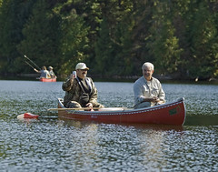 Wayne and Gary - Trout Fishing (Rock Steady Images) Tags: red summer lake ontario canada canon fishing paddle canoe handheld cheers 200views rebelxt 50views troutfishing minnowbucket 25views photoshopcs3 canonef70300mmf456 7pointsystem garygautier bypaulchambers topazvivacity wayneshaw houstonlakecamp rocksteadyimages