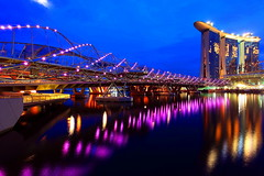 Marina Bay Sands open today! (Mel Mijares) Tags: longexposure bridge gambling money tourism night reflections river yahoo flyer singapore raw quality violet f1 casino double best explore entertainment esplanade wikipedia skytower times helix frontpage fullerton merlion mbs skypark 1740f4l helixbridge nonhdr abigfave marinabaysands 5dmkii singaporedaily yahoomarinabaysands april272010 yahoosgmarinabaysands marinabaysandsskypark marinabayskypark
