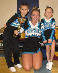 Malik, Cassandra, and Harmony (happy housewife2007) Tags: boy woman white black girl coach cheerleaders teal first competition siblings harmony cassandra trophy springfield firstplace malik shs winners allstars ssc teamates springfieldhighschool southsidecheer