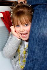 Hide and Seek (Amanda Fullam (tgifullzum)) Tags: blue girl beautiful smile child happiness jewelry plastic blonde eyed flickrchallengegroup flickrchallengewinner