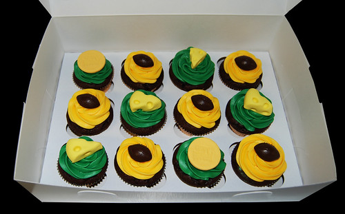 green and yellow football cupcakes