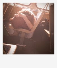 PAD 20090709 IMG_0269 (efroten) Tags: sleeping sunlight chicago train polaroid afternoon cta publictransportation pad sunny el commute napping commuting asleep redline camerabag iphone chicagoist camerabagapp july9th2009