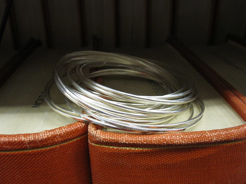 2 sets of silver bangle bracelts