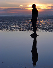 Light headed (Mr Grimesdale) Tags: sunset seascape reflection beach silhouette statue liverpool sony mersey gormley crosby antonygormley merseyside anotherplace rivermersey mrgrimsdale stevewallace dsch2 gormleystatue europeancapitalofculture2008 mrgrimesdale