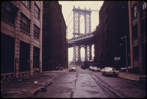 Manhattan Bridge Tower in Brooklyn, New York City, Framed through Nearby Buildings...06/1974